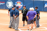 Umpires and coaches meeting at home plate